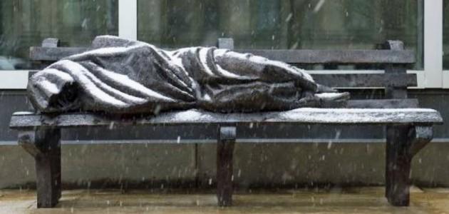 statue of homeless man